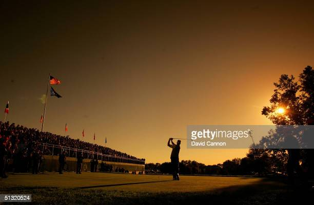 European Team player Darren Clarke of Ireland drives off the first tee during his four-ball match against Tiger Woods and Chris Riley of the USA in...