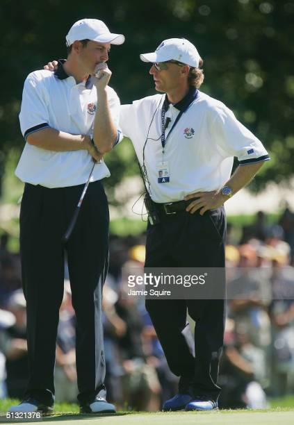 European team player David Howell of England chats with European Captain Bernhard Langer during their morning four-ball match against Jim Furyk and...