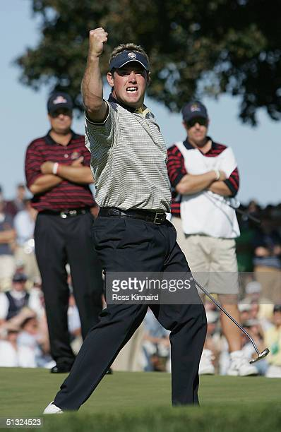 European team player Lee Westwood celebrates on the 18th green after holing his putt to win his match against Kenny Perry of the USA during the...