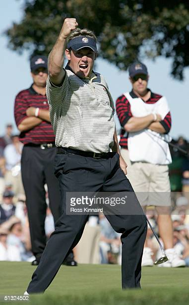 European team player Lee Westwood of England celebrates on the 18th green after holing his putt to win his match against Kenny Perry of the USA...