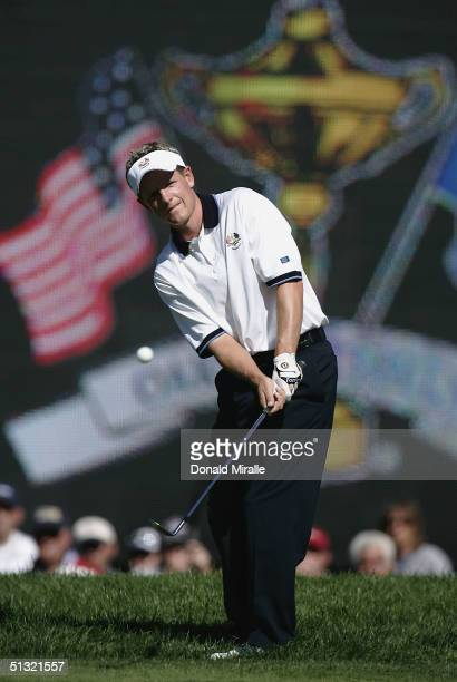European team player Luke Donald of England watches a pitch shot on the fifth hole during his afternoon foursome match against Jim Furyk and Fred...