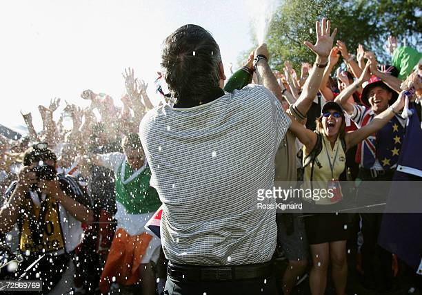 European team player Paul McGinley sprays cahmpagne into the crowd after Europe win the Ryder Cup 18 1/2 to 9 1/2 at the 35th Ryder Cup Matches at...