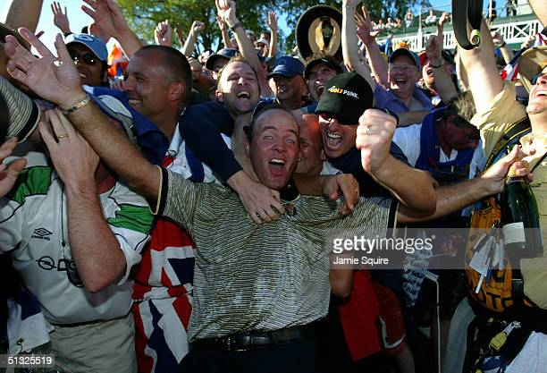 European Team player Thomas Levet is mobbed by the fans after Europe's victory over the USA during the Sunday singles matches at the 35th Ryder Cup...
