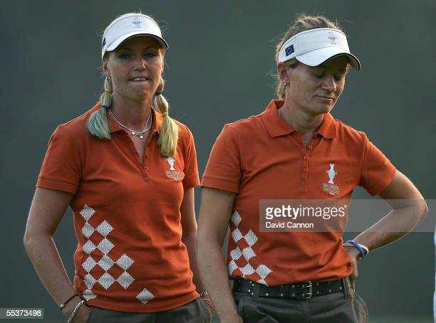 European team players Carin Koch and Catriona Matthew watch the play on the 18th hole during the Saturday afternoon four-ball matches at the Solheim...