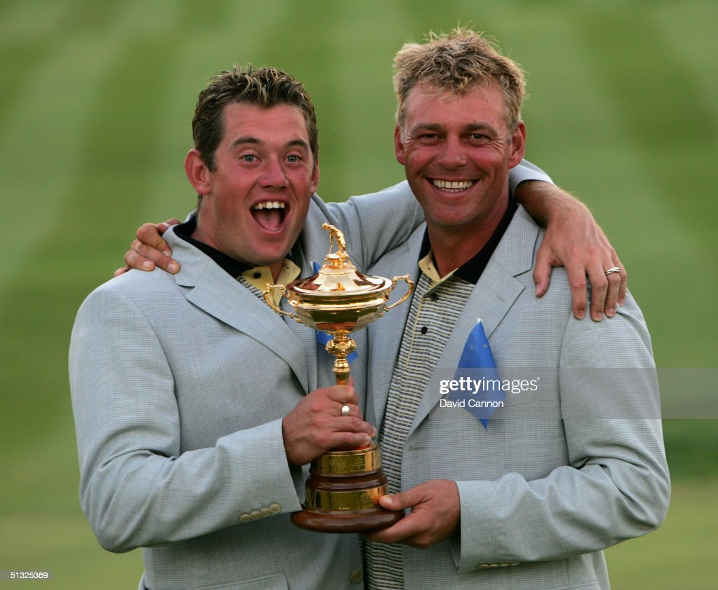 European team players Darren Clarke and Lee Westwood with the trophy after Europe's victory over the USA 18 1/2 to 9 1/2 at the 35th Ryder Cup Matches at the Oakland Hills Country Club on September 19, 2004 in Bloomfield Township, Michigan.