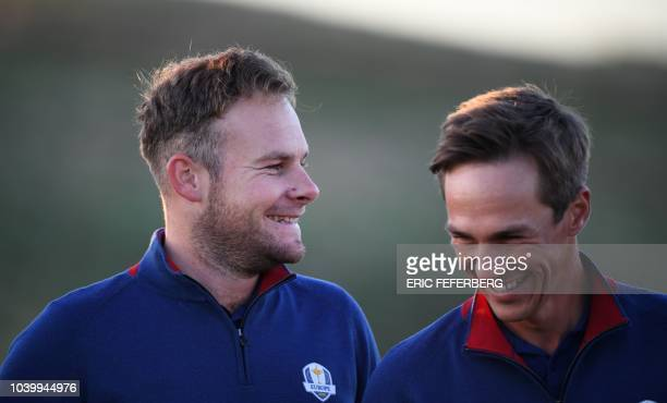 European team players Europe's English golfer Tyrell Hatton and Europe's Danish golfer Thorbjorn Olesen pose for a group photograph ahead of the 42nd...