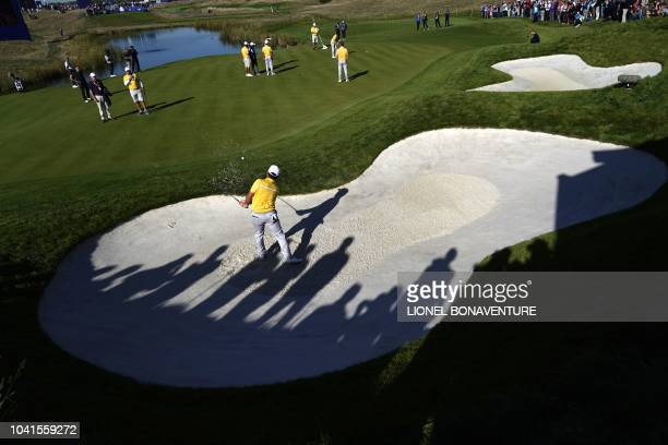 TOPSHOT European team players gather on a green during a practice session ahead of the 42nd Ryder Cup at Le Golf National Course at...