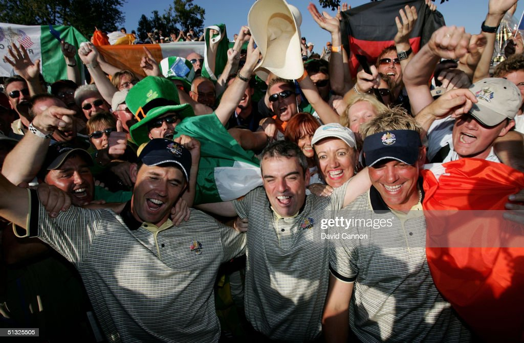 European Team players Padraig Harrington, Paul McGinley and Darren Clarke of Ireland celebrate with the fans after Europe's victory over the USA during the Sunday singles matches at the 35th Ryder Cup Matches on September, 19 2004 at the Oakland Hills Country Club in Bloomfield Township, Michigan.