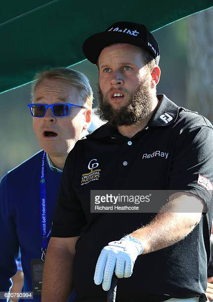 European Tour Chief Executive Keith Pelley looks on with Andrew Johnston of England the 1st tee during day one of the Turkish Airlines Open at the...