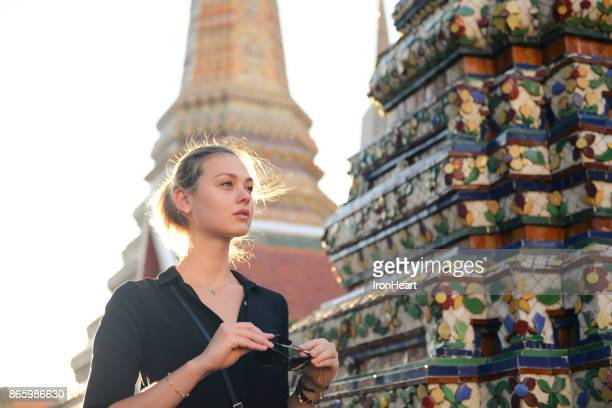 european tourist beautiful woman is visiting at wat pho in bangkok, thailand. - buddha stock pictures, royalty-free photos & images