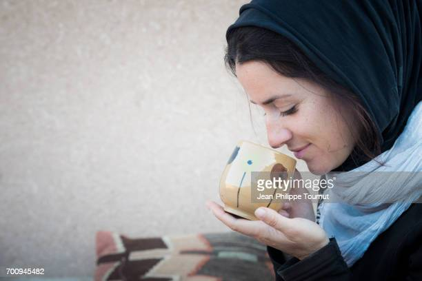 european tourist lady drinking tea in yazd, iran - iranian culture stock photos and pictures
