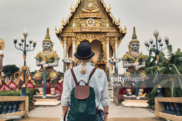 european tourist visiting asian temple wat plai laem - surat thani province stock pictures, royalty-free photos & images