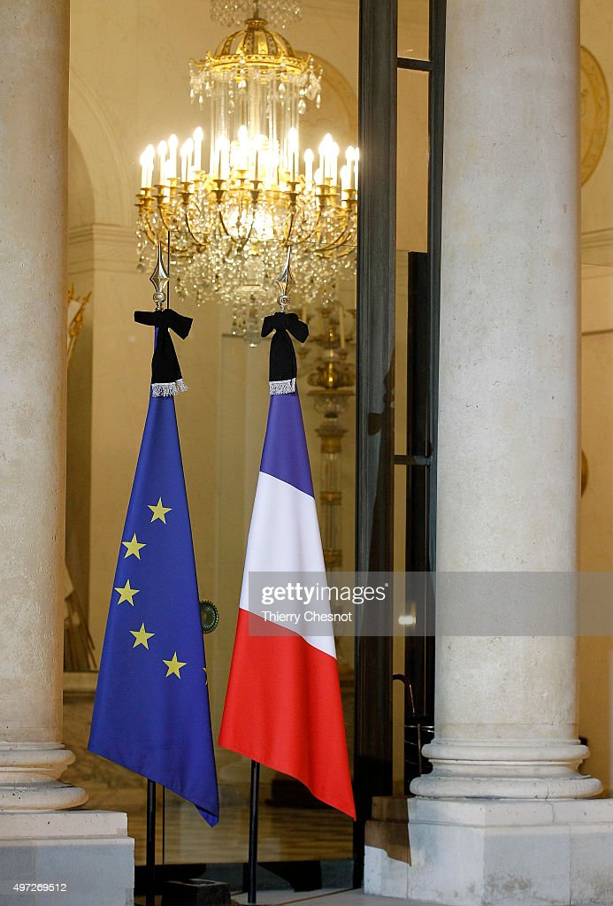 A European Union and a French flag with a black bow are seen at the Elysee Palace on November 15, 2015 in Paris, France. French President Francois Hollande meets party leaders today after a series of fatal shootings in Paris on Friday.