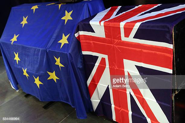 European Union and British Union Jack flags hang at a meeting for British citizens living in Germany to discuss the implications of Great Britain...