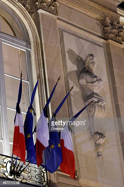 European Union and French flags with black bows are seen at the Elysee Palace on November 15 2015 in Paris France French President Francois Hollande...