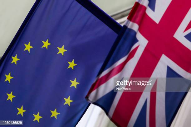 European Union and Great Britain flags are seen on the building in Krakow, Poland on January 5, 2020.