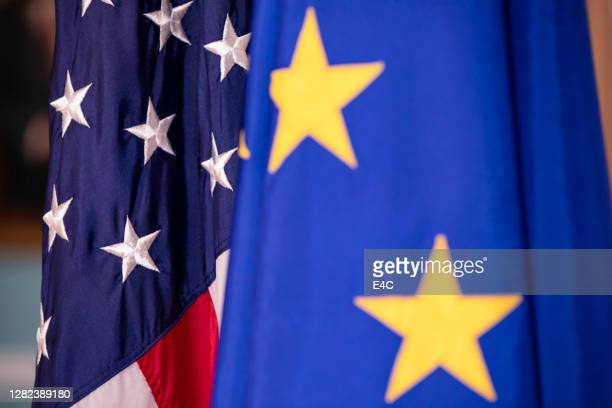 european union and united states flags on display - tariff stock pictures, royalty-free photos & images