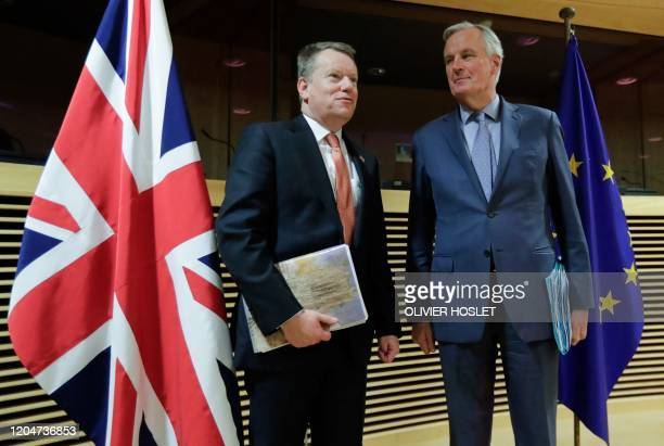European Union chief Brexit negotiator Michel Barnier and the British Prime Minister's Europe adviser David Frost pose for a photograph at start of...