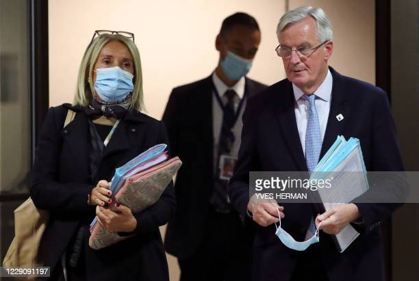 European Union chief Brexit negotiator Michel Barnier leaves after a press conference on the first day of the face-to-face European Union summit at...