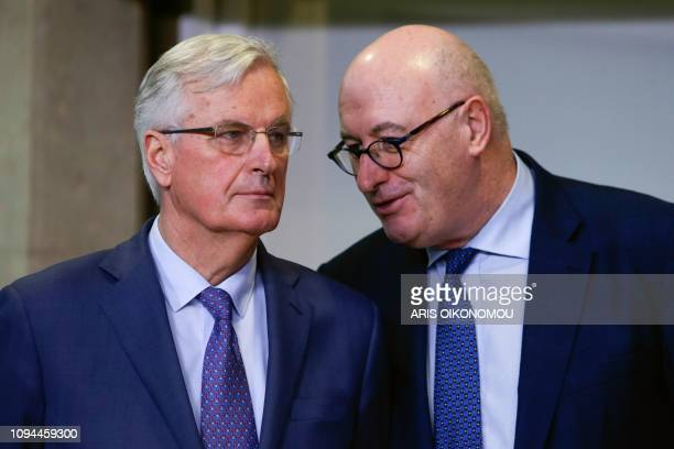 European Union chief Brexit negotiator Michel Barnier listens to EU Commissioner of Agriculture and Rural Development Phil Hogan as they attend a...