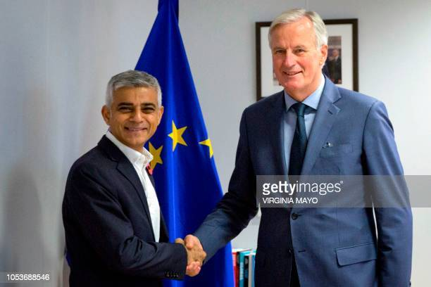 European Union chief Brexit negotiator Michel Barnier shakes hands with London Mayor Sadiq Khan prior to a meeting at the EU headquarters in Brussels...