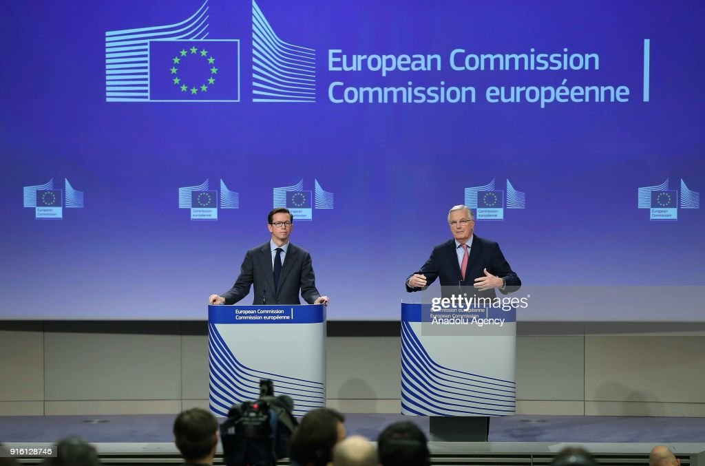 European Union Chief Brexit Negotiator Michel Barnier (R) speaks during a press conference on the Brexit negotiations in Brussels, Belgium on February 9, 2018.