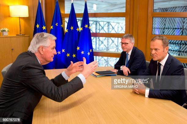 European Union chief Brexit negotiator Michel Barnier speaks with European Council President Donald Tusk prior to a meeting at the Europa building in...