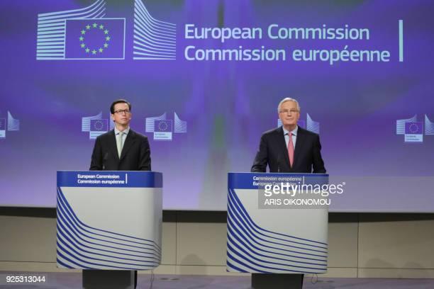 European Union Chief Negotiator in charge of Brexit negotiations Michel Barnier speaks beside EU deputy chief spokesperson Alexander Winterstein...