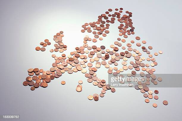 European Union coins arranged into the shape of Europe