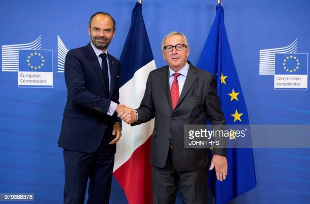 European Union Commission President Jean Claude Juncker welcomes French Prime Minister Edouard Philippe upon his arrival for a meeting at the EU...