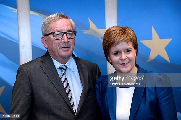 European Union Commission President JeanClaude Juncker poses with Scotland's First Minister and Leader of the Scottish National Party Nicola Sturgeon...