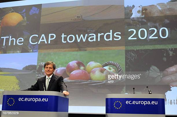 European Union Commissioner for Agriculture and Rural Development Dacian Ciolos gestures while talking to the media during a press conference at the...