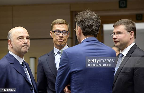 European Union Commissioner for Economic and Financial Affairs Pierre Moscovici Finnish Finance Minister Alexander Stubb and European Union...