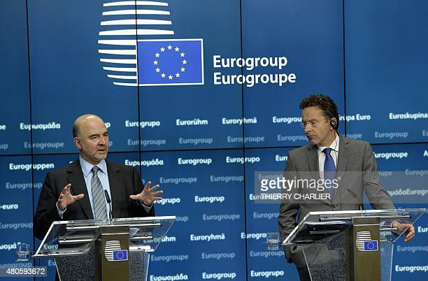 European Union Commissioner for Economic and Monetary Affairs Pierre Moscovic gestures during a press conference after the reelection of Current...