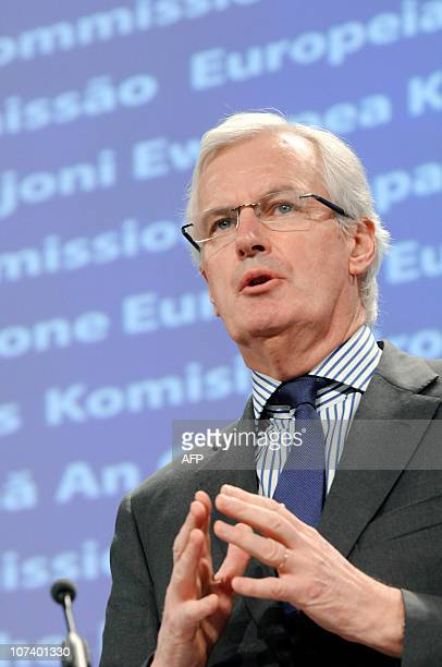 European Union Commissioner for Internal Market and Services Michel Barnier gestures while talking to the media during a press conference at the EU...