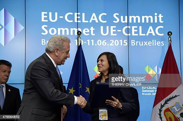 European Union Commissioner for Migration Home Affairs and Citizenship Dimitris Avramopoulos shakes hands with Peru's Foreign Affairs Minister Ana...