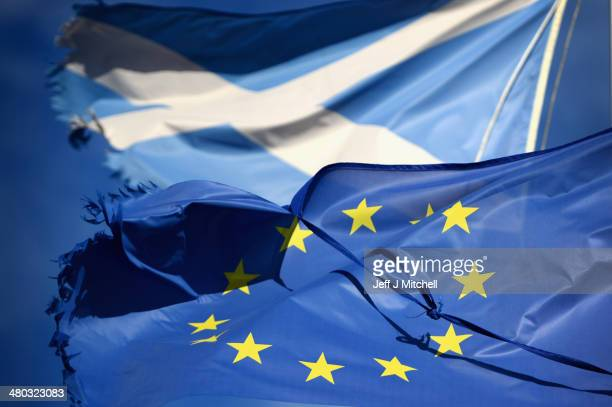 European Union flag and Saltire flag blow in the wind near to Glen Coe on March 24 2014 in Glen Coe Scotland A referendum on whether Scotland should...