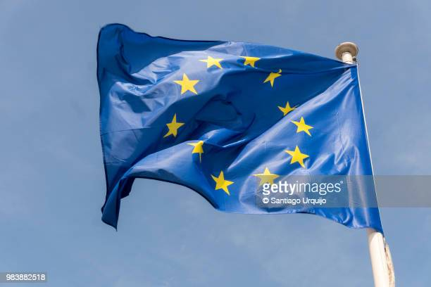 european union flag at berlaymont building - europe stock-fotos und bilder