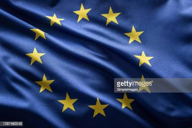 european union flag blowing in the wind. - europe stock-fotos und bilder
