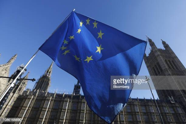 European Union flag flies during ongoing pro and anti Brexit protests outside the Houses of Parliament in London, U.K., on Tuesday, Jan. 22, 2019....