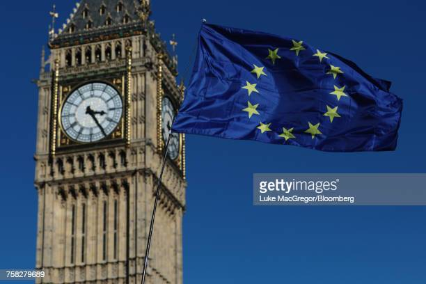 a european union (eu) flag flies in front of big ben - big mac stock pictures, royalty-free photos & images