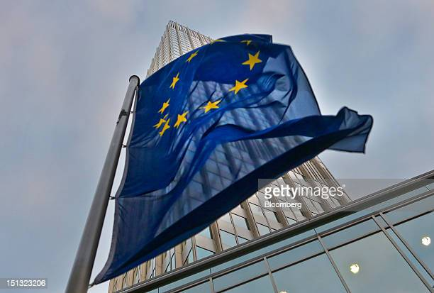 European Union flag flies outside of the headquarters of the European Central Bank in Frankfurt, Germany, on Wednesday, Sept. 5, 2012. Predictions of...