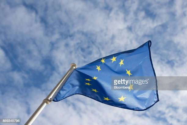 A European Union flag flies outside the European Convention Center during a Eurogroup meeting of European finance ministers in Luxembourg on Monday...