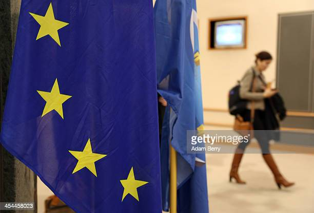 European Union flag hangs in the European Parliament building on December 4 2013 in Brussels Belgium The legislative body also has representation in...