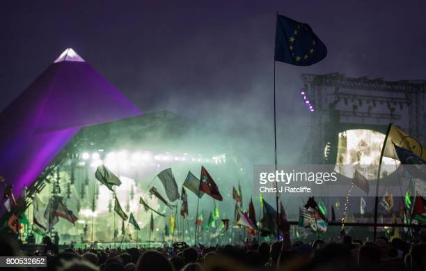 European Union flag is seen in the crowd as Radiohead headline on the Pyramid Stage at Glastonbury Festival Site on June 24 2017 in Glastonbury...