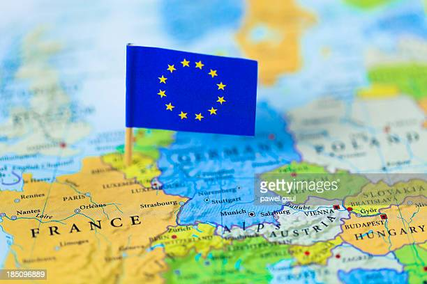 European Union flag over Europe map