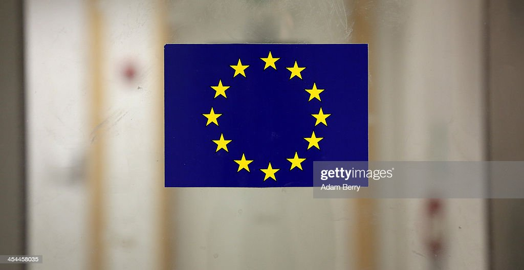 A European Union flag sticker is seen on a door in the European Parliament building on December 4, 2013 in Brussels, Belgium. The legislative body also has representation in Strasbourg and Brussels.