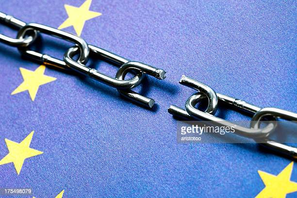 european union flag with broken chain - european union symbol stock photos and pictures