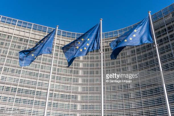european union flags at berlaymont building of the european commission - european union stock pictures, royalty-free photos & images