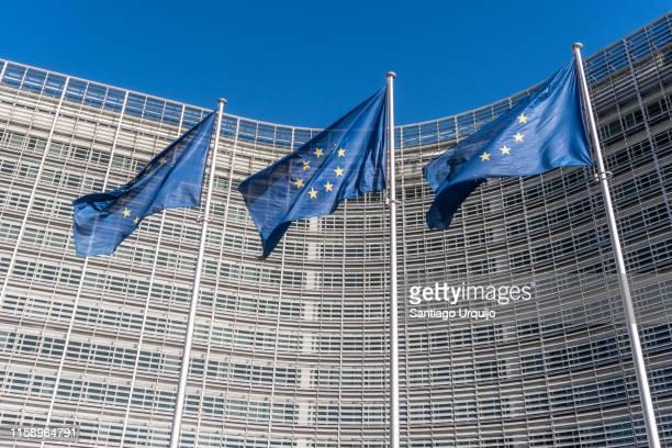 european union flags at berlaymont building of the european commission - 欧州共同体 ストックフォトと画像